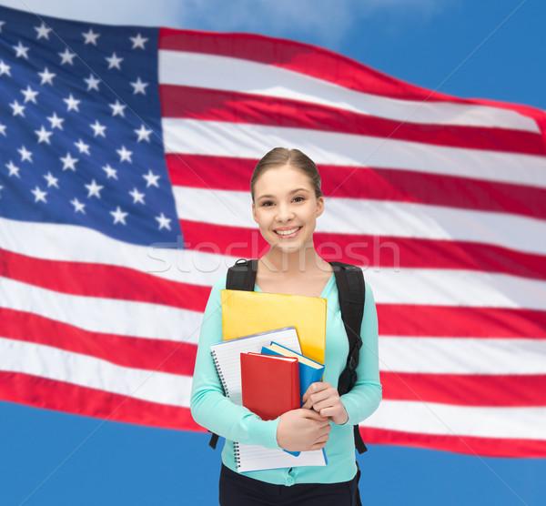happy and smiling teenage girl Stock photo © dolgachov