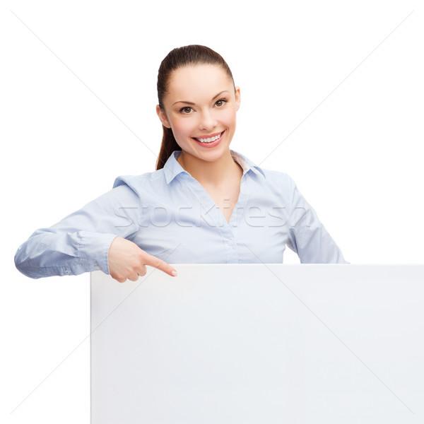 Mujer de negocios senalando dedo blanco bordo negocios Foto stock © dolgachov