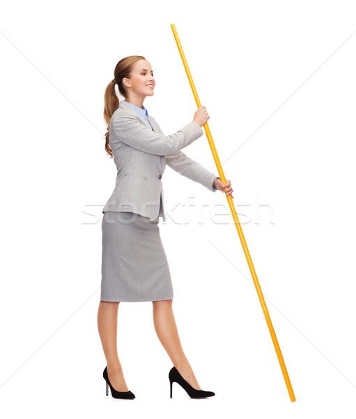 улыбающаяся женщина флагшток мнимый флаг бизнеса Сток-фото © dolgachov