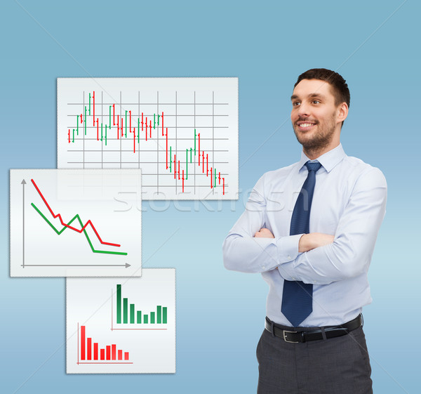 handsome businessman with crossed arms Stock photo © dolgachov