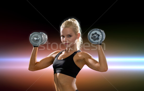 Donna pesante acciaio manubri fitness Foto d'archivio © dolgachov