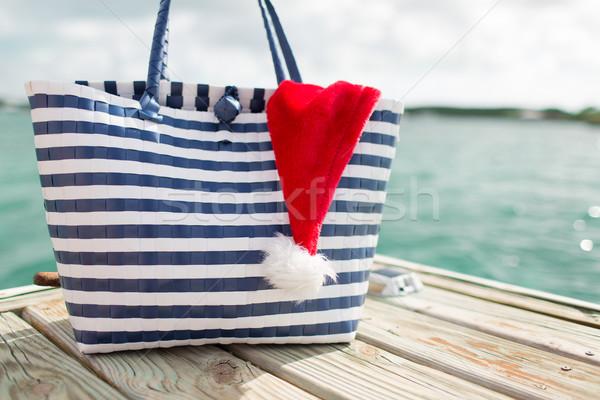Święty mikołaj pomocnik hat plaży Zdjęcia stock © dolgachov