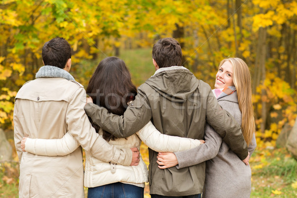 Stock photo: group of smiling men and women in autumn park