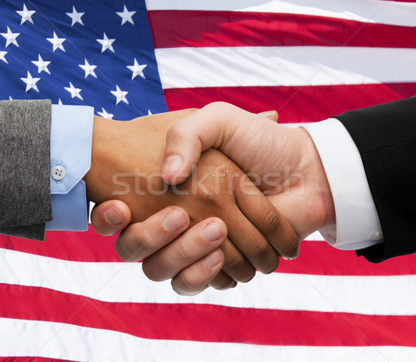 close up of handshake over american flag Stock photo © dolgachov