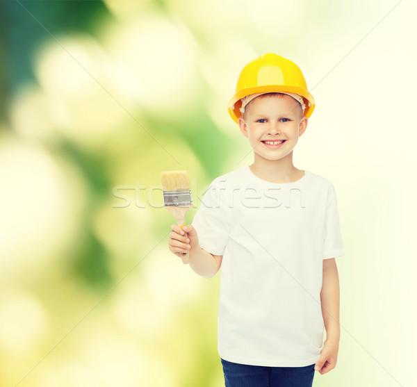 Gülen küçük erkek kask fırça boya meslek Stok fotoğraf © dolgachov
