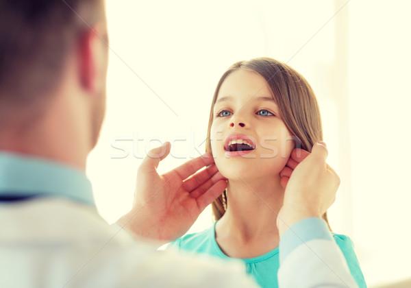 male doctor checks little girl lymph nodes Stock photo © dolgachov