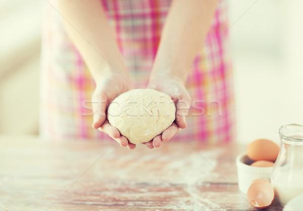 close up of female hands holding bread dough Stock photo © dolgachov