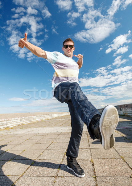 handsome boy making dance move Stock photo © dolgachov