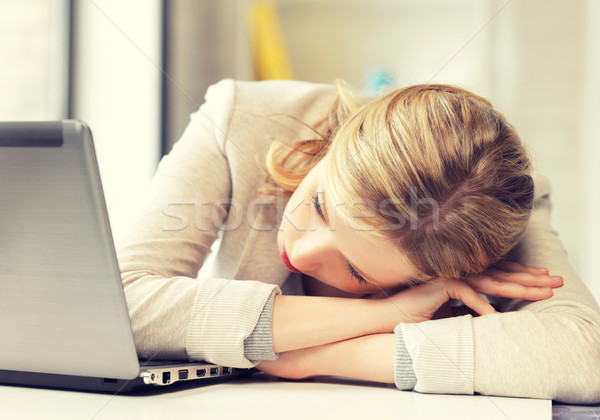 Stock photo: tired woman with laptop computer