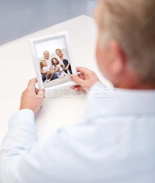 close up of old man holding happy family photo Stock photo © dolgachov