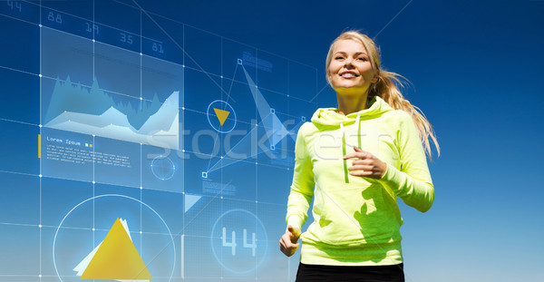 woman jogging outdoors Stock photo © dolgachov