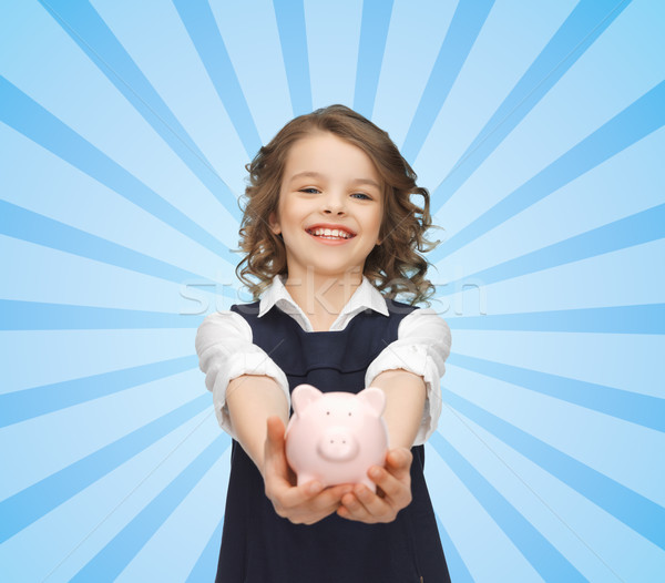 happy girl holding piggy bank on palms Stock photo © dolgachov