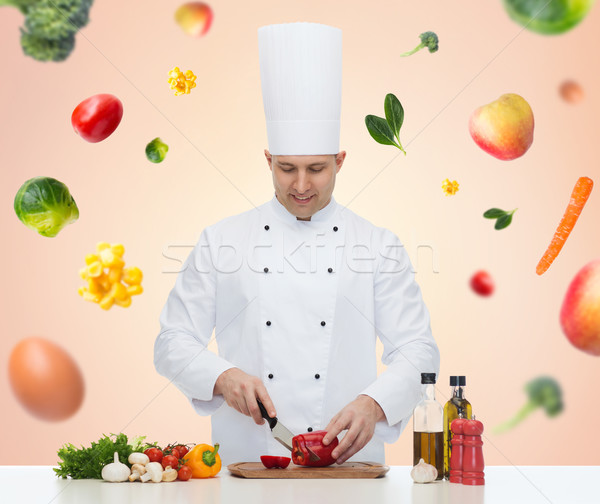 happy male chef cook cooking food Stock photo © dolgachov