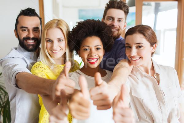 happy creative team in office Stock photo © dolgachov