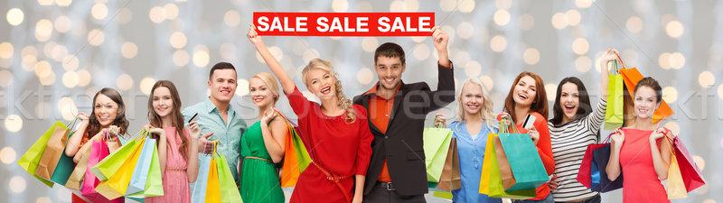 Pessoas felizes vermelho venda assinar Foto stock © dolgachov