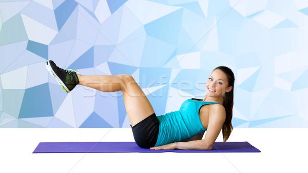 Mosolygó nő abdominális izmok fitnessz sport képzés Stock fotó © dolgachov