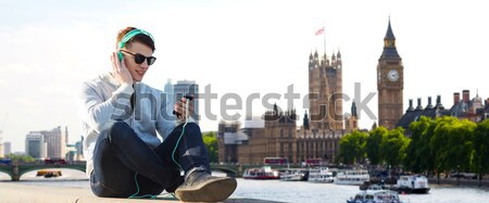 close up of male gay couple hugging over big ben Stock photo © dolgachov