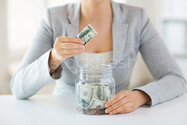 close up of woman hands and dollar money in jar Stock photo © dolgachov
