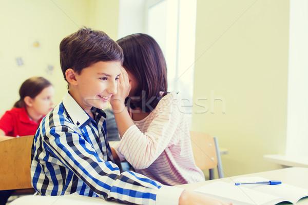 Mosolyog iskolás lány suttog osztálytárs fül oktatás Stock fotó © dolgachov