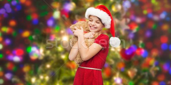 Uśmiechnięty dziewczyna Święty mikołaj pomocnik hat miś Zdjęcia stock © dolgachov