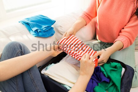 close up of lesbian couple with rainbow flags Stock photo © dolgachov