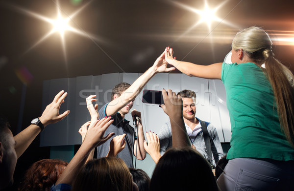 fan making high five with singer at club concert Stock photo © dolgachov