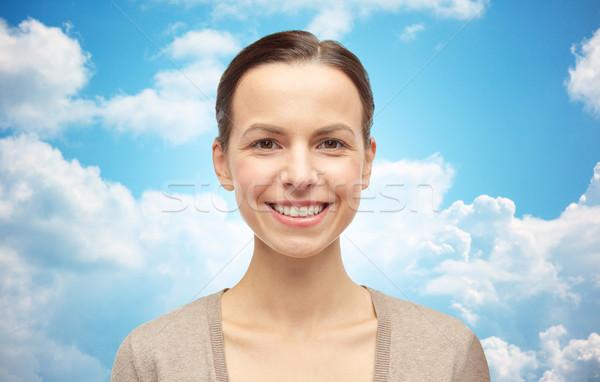 Sorrindo cardigã blue sky nuvens feminino sexo Foto stock © dolgachov