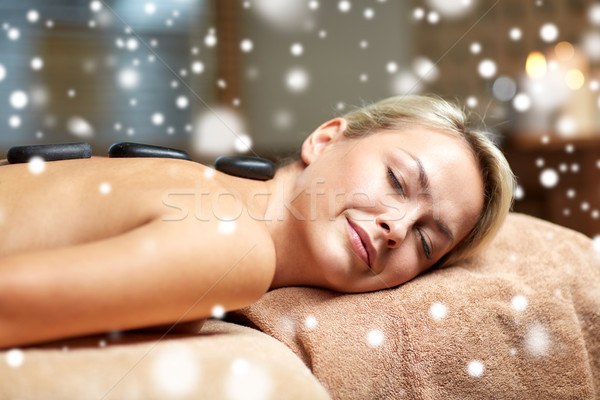 close up of woman having hot stone massage in spa Stock photo © dolgachov