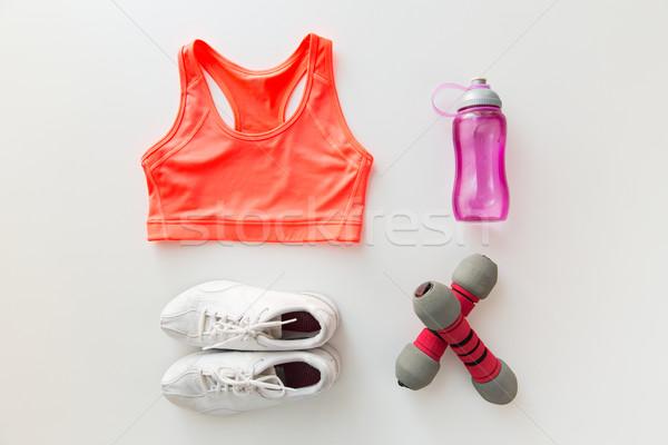 close up of sportswear, dumbbells and bottle Stock photo © dolgachov