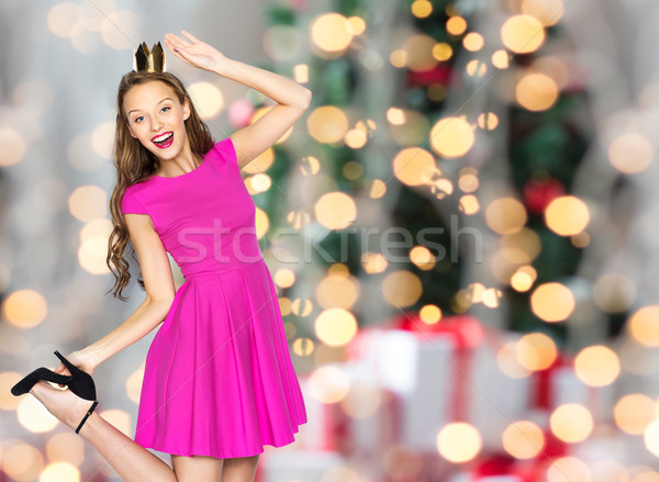 happy woman crown over christmas lights Stock photo © dolgachov
