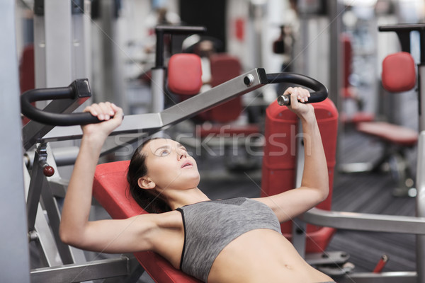 Stockfoto: Jonge · vrouw · gymnasium · machine · sport · fitness