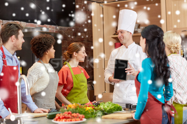 happy friends with chef and tablet pc in kitchen Stock photo © dolgachov