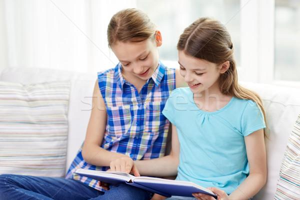 Сток-фото: два · счастливым · девочек · чтение · книга · домой