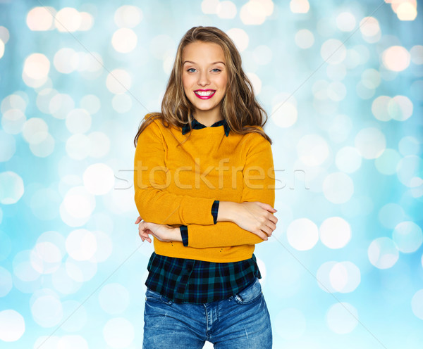happy young woman or teen girl in casual clothes Stock photo © dolgachov