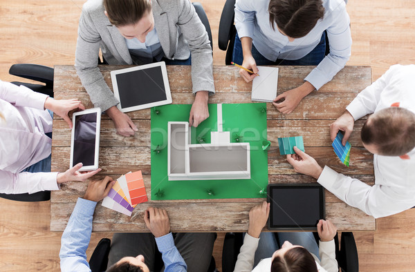close up of business team with project layout Stock photo © dolgachov