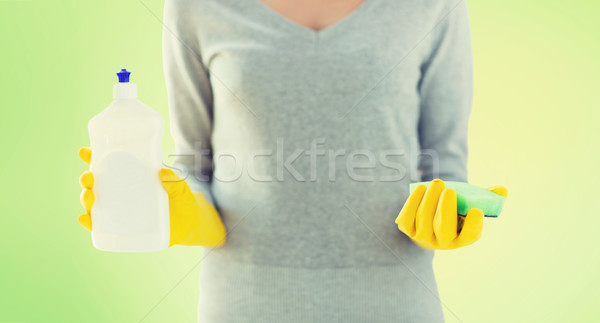 close up of woman with sponge and cleanser Stock photo © dolgachov