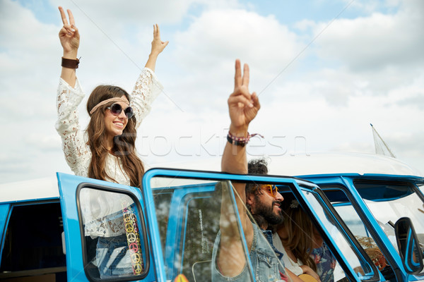 hippie friends over minivan car showing peace sign Stock photo © dolgachov
