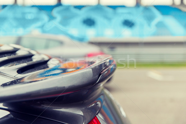 close up of car spoiler on speedway at stadium Stock photo © dolgachov