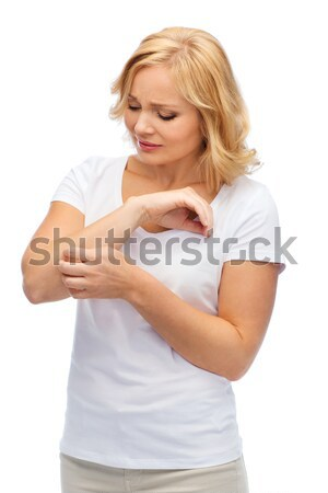 unhappy woman suffering from hand inch Stock photo © dolgachov