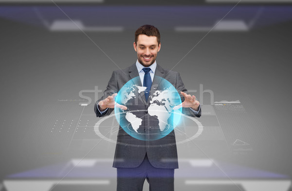 businessman with virtual earth globe projection Stock photo © dolgachov