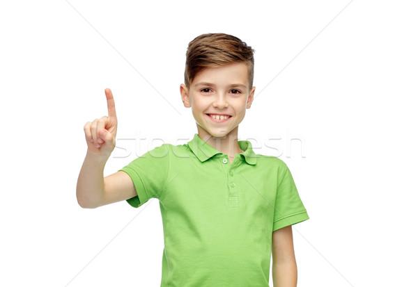 happy boy in green polo t-shirt pointing finger up Stock photo © dolgachov