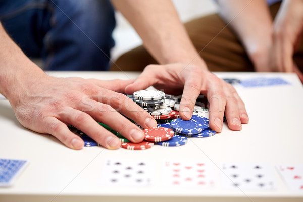 hands with casino chips making bet or taking win Stock photo © dolgachov