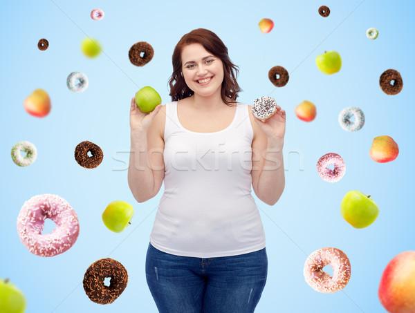Boldog plus size nő választ alma fánk Stock fotó © dolgachov