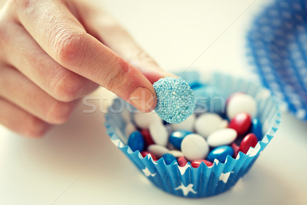 close up of hand with candies on independence day Stock photo © dolgachov