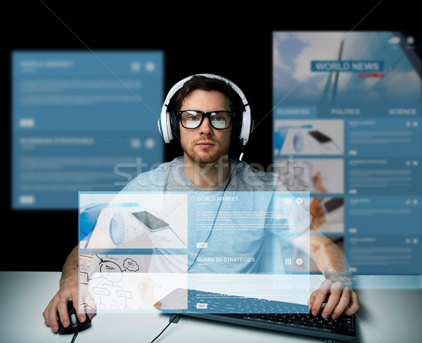 Stock photo: man in headset computer over virtual media screens