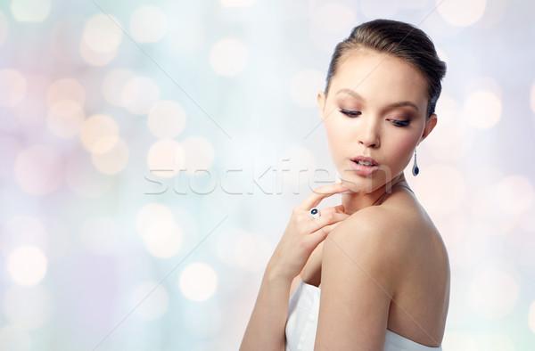 Bella donna orecchino anello bellezza gioielli persone Foto d'archivio © dolgachov