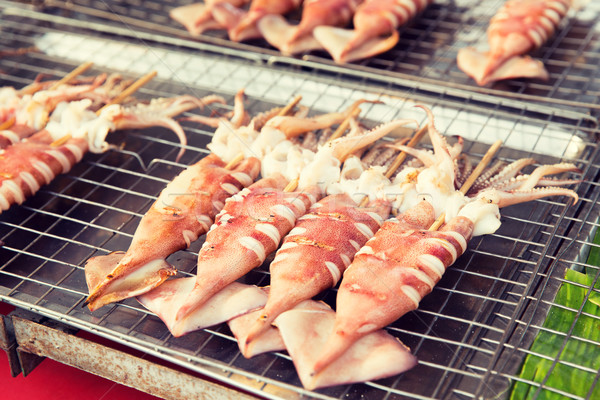 grilled squids at street market Stock photo © dolgachov