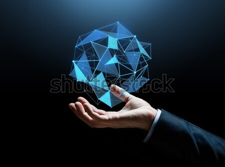 man with virtual low poly projection on hand Stock photo © dolgachov
