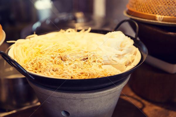 bowl of rice noodles garnish at asian restaurant Stock photo © dolgachov