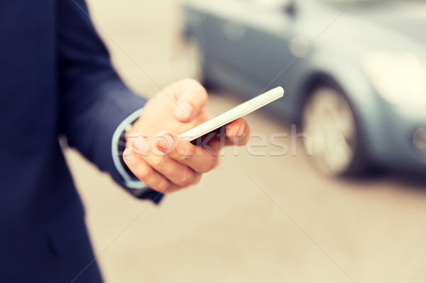close up of man hand with smartphone and car Stock photo © dolgachov